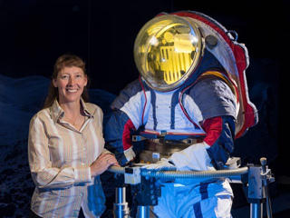 Spacesuit designer Amy Ross stands with a prototype spacesuit