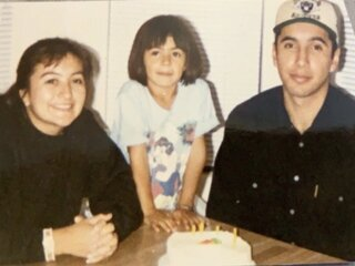 Christina and her parents at her early childhood home in Gardena, California.