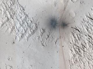 A Criss-Cross Landscape with Fresh Craters