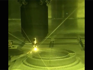 3D printing technique where a printer head scans over each layer of a part, blowing metal powder that is melted by a laser