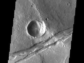 This image from NASAs Mars Odyssey shows a linear depression, part of Sirenum Fossae.
