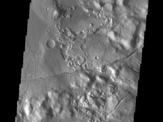 This image from NASAs Mars Odyssey shows part of Gorgonum Chaos. Chaotic regions form when groundwater escapes to the surface, undermining it and causing the ground to collapse.