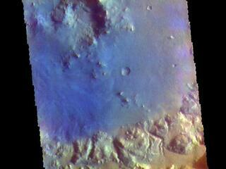 This image from NASAs Mars Odyssey shows a crater in Arabia Terra. Dark blue in this filter combination indicates basaltic sand.