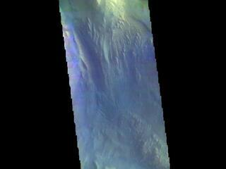 This image from NASAs Mars Odyssey shows a cross section of Hebes Chasma. Hebes Chasma is a closed basin located north of Valles Marineris.