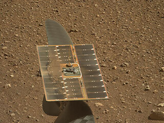 The solar panel of NASA's Ingenuity Mars Helicopter's solar panel as seen by Mastcam-Z, a pair of zoomable cameras aboard NASA's Perseverance Mars rover.
