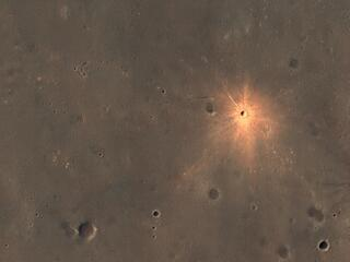 A New Impact Crater with Bright Ejecta